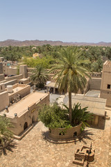 Aerlial view of Nizwa oasis and surrounding mountains