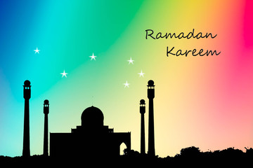 silhouette of masjid on colorful background