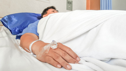 close up of saline solution preparation on hand of man patient