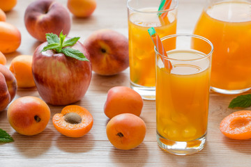 Apricot peach apple juice with ice.
