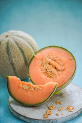 whole and halves on cantaloupe melon