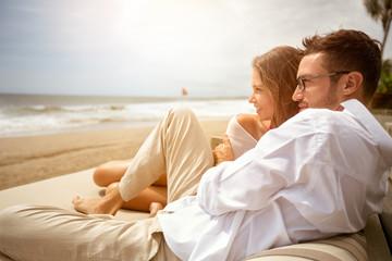 Obraz Young couple enjoying on beach - fototapety do salonu