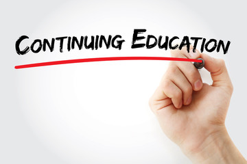 Hand writing Continuing Education with marker, concept background