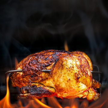 Rotisserie Chicken Cooking Over Open Flames