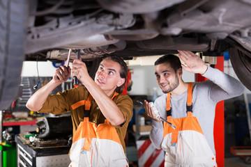 two successful car mechanics
