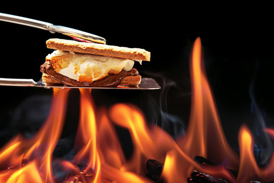 Smore Cooking Over Campfire