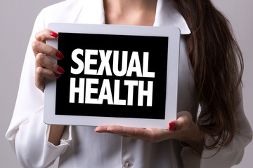Female doctor holding a tablet with the text: Sexual Health