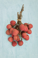 Fresh lychee from Thailand on blue background