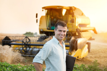 Agricultural engineer on wheat harvest Wall mural