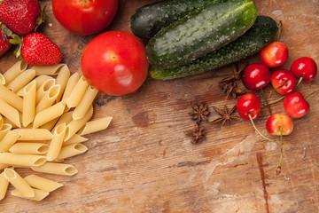 Italian food ingredients on flat wooden background