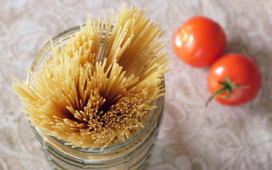 Uncooked spaghetti in a jar of glass