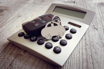 Car shape keyring and key on calculator