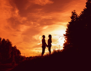 Young couple at sunset in the park.