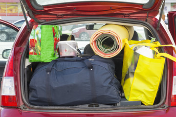 bags and things in the trunk of a car