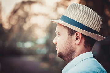 Portrait of handsome bearded man with hat. Space for text. Toned photo.