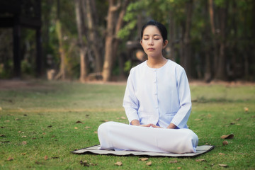 Woman meditation to calm the mind and happiness.