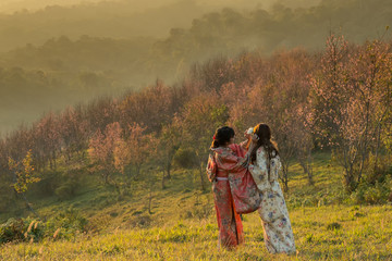 Sister take care of her sister among the mountains of cherry blossoms.Japanese culture.