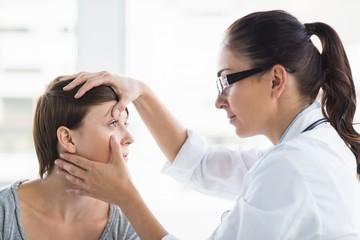 Doctor checking woman eye