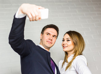 Two successful business people taking a happy Selfie in the office.