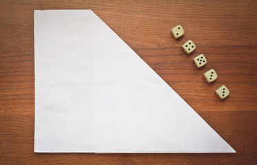 note and dice concept