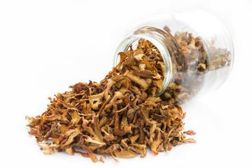 Dried chanterelle mushrooms in a jar