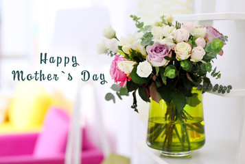 Happy Mothers Day. Beautiful bouquet of colourful roses in glass vase