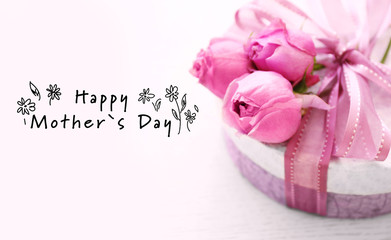 Happy Mothers Day. Gift box with beautiful roses on wooden background