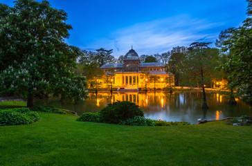 Night view of Crystal Palace (Palacio de cristal) in Retiro Park in Madrid, Spain