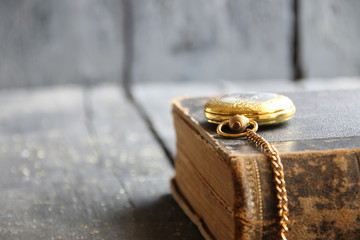 Vintage background with pocket watch and book