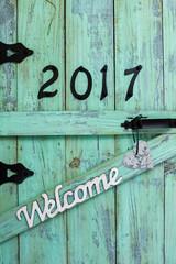 Welcome 2017 hanging on old wooden door