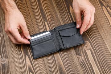 Black man's wallet in man hands