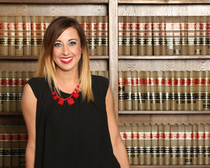 Young attractive female lawyer in law library, Women in business