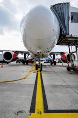 Tuinposter Vliegtuig passenger jet at airport