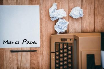 Composite image of word merci papa