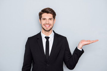 Smiling happy man making presentation of new product