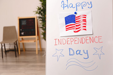 Child's drawing of American flag on flip chart