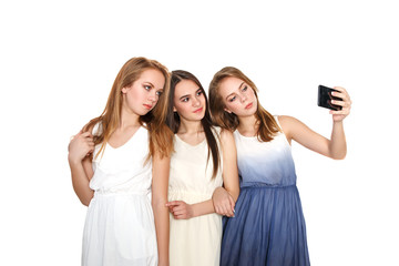 3 Beautiful young girls taking a photo