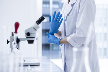 Researcher is with the laboratory gloves