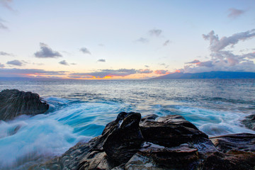 Black lava rock beach, road to Hana, Maui.