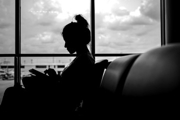 silhouette of Woman at airport in sunset