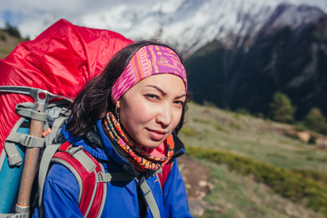 Woman portrait in the mountains during hiking in Caucasus