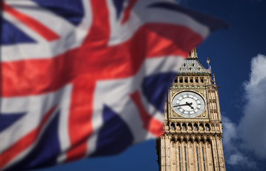 British union jack flag and Big Ben Clock Tower and Parliament house at city of westminster in the background - UK votes to leave the EU
