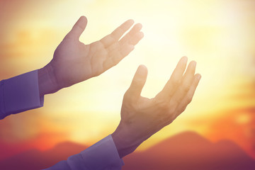 Hand of man pray for sky
