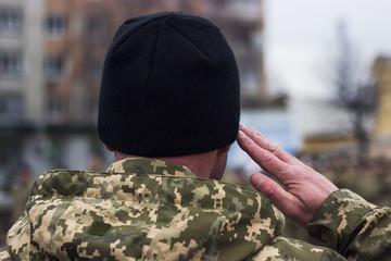 Military saluting at parade