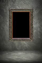 antique wooden frame on cement background