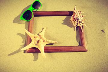 Frame on sand on the beach.