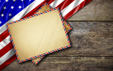 USA flag on wooden table, high contrast and over light