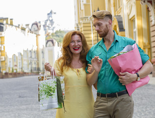 happy couple man and woman with shopping bags