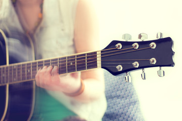 close up shot of strings and guitarist hands playing guitar