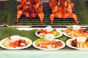 grilled or fried chicken on plate at street market